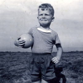 Photo of the author John Rigg as a small boy holding a football