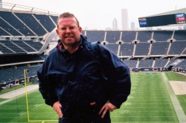 Photo of the author John Rigg as a he is now, in a sports stadium